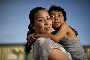 "Crystal Nguyen, a former inmate at Valley State Prison seen with son Neiko Nguyen, said she worked in the prison infirmary. She said she often heard the medical staff ask repeat offenders to agree to be sterilized. ""I was like, 'Oh my God, that's not right,' "" Nguyen recalls. / Noah Berger For the Center for Investigative Reporting"