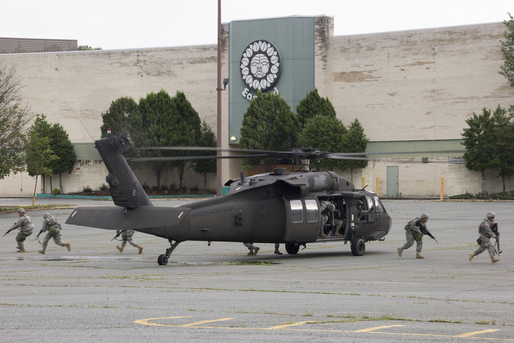 Charlotte, N.C. — Soldiers exit a UH-60 Blackhawk during a Rapid Reaction Force (RRF) exercise at the Eastland Mall in Charlotte on June 11th. The RRF exercise is an opportunity for the North Carolina National Guard to highlight special skills to provide valuable support to our communities, throughout the state, during catastrophic homeland events. Photo by Grant Baldwin Photography.