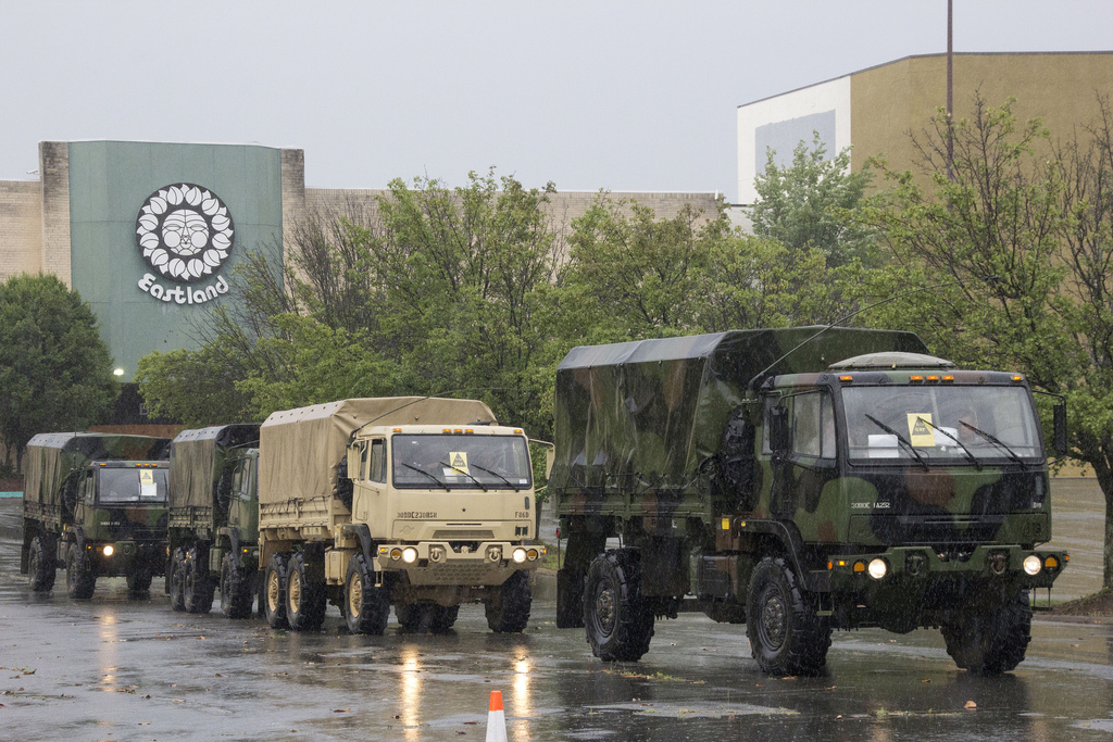 Charlotte, N.C. — National Guard vehicles parked during a Rapid Reaction Force training exercise at Eastland Mall. The exercise was put on hold briefly, due to heavy rains. Photo by Grant Baldwin Photography.