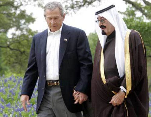 """Image:  Former-US President George Bush and King for Life of Saudi Arabia, Abdullah bin Abdulaziz al Saud:""""The loving parents of Al Qaeda."""" From the 1980's to present day, the US and Saudi Arabia have funded, armed, and directed Al Qaeda while performing propaganda campaigns to bend public perception regarding the terrorist organization - portraying them as heroes, then villains, and back again. The """"War on Terror"""" is a fraud."""