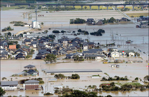 An aerial view shows residential areas flooded by the Yura river after tropical storm Man-yi, also known locally as Typhoon No.18, hit in Fukuchiyama, Kyoto prefecture, in this photo taken by Kyodo September 16, 2013. (Reuters / Kyodo)