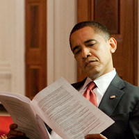 President Obama going over his lies and disinformation prior to a speech.