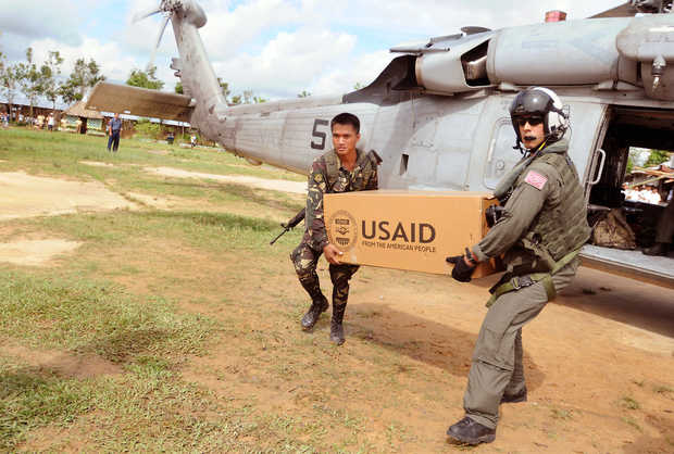 The U.S. Navy delivers emergency aid to the Philippines in 2008 after Typhoon Fengshen. Working together a soldier from the Philippine Army and Petty Officer 2nd Class Anthony Chavez move relief supplies to a school on the Island of Panay on July 1, 2008. A member of Helicopter Anti-Submarine Squadron 4, Chavez has been flying humanitarian missions into the island in the wake of Typhoon Fengshen. At the request of the government of the Republic of the Philippines, the USS Ronald Reagan is off the coast of Panay Island providing humanitarian assistance and disaster relief. The Ronald Reagan is operating in the 7th Fleet area of responsibility to support maritime security operations. DoD photo by Senior Chief Spike Call, U.S. Navy. (Released) CHIEF PETTY OFFICER SPIKE CALL — Senior Chief Mass Communication