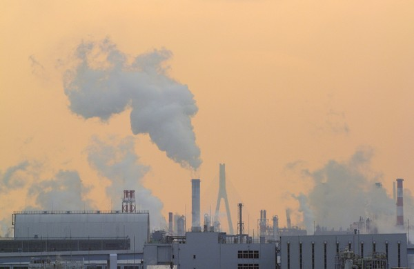 The 90 biggest producers of fuels driving climate change include investor-owned corporations, such as Exxon Mobil and Chevron, and state-owned oil companies, such as Saudi Aramco and Mexico's Pemex. Above, a plant in Tokyo. (FRANCK ROBICHON, EPA / November 21, 2013)