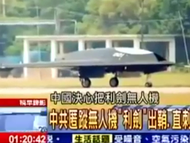 JDUS2020 / YouTubeA screen grab from Chinese TV shows China's first unmanned stealth drone making its first test flight.