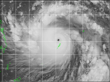 A satellite image shows Super Typhoon Haiyan spinning in the western Pacific as it moves west toward the Philippines (at the left in the green outlines).(Photo: Joint Typhoon Warning Center)