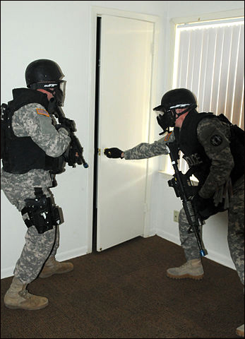 Members of the Special Reaction Team with the 178th Military Police Detachment, 89th Military Police Brigade, raid a house in Wainwright Village during a new training exercise at Fort Hood, Texas, March 5, 2013.