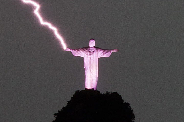 Lightning strikes the right hand of the statue Christ the Redeemer in Rio de Janeiro, Brazil on January 16, 2014. Photo: EPA