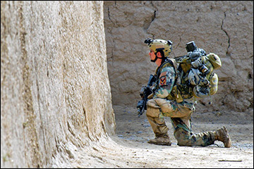 U.S. Special Forces soldier provides security during clearing operation with Afghan commandos, Zharay district, Kandahar province, Afghanistan.