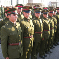 Chinese officers stand at attention in Tonghua, Jilin, China. Credit: Rivard via Flickr