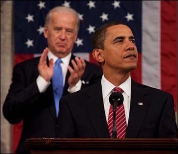 Vice President Biden stands behind President Barack Obama.