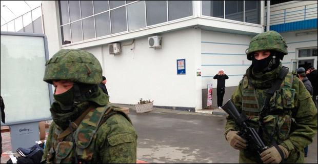 Unidentified soldiers patrol outside Simferopol International Airport on February 28, 2014.