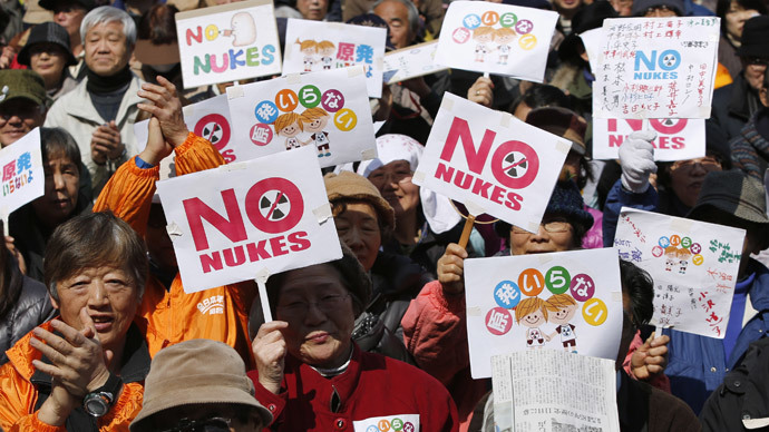 """Anti-nuclear protesters hold banners saying """"No Nukes"""" before they march in Tokyo March 9, 2014.(Reuters / Yuya Shino)"""