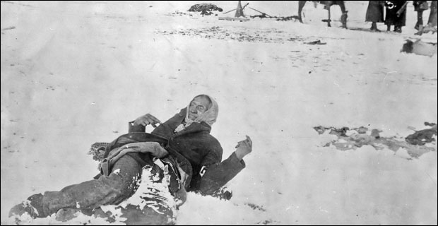 """""""The final flickers of Indian resistance were extinguished by Leviathan in the bloody snows of Wounded Knee."""" Photo: The slain body of Chief Big Foot propped up in the snow at Wounded Knee."""