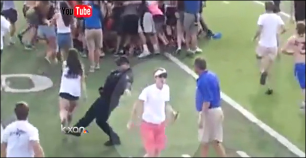 Screen capture from Youtube video shows officer failing to trip a high school student.