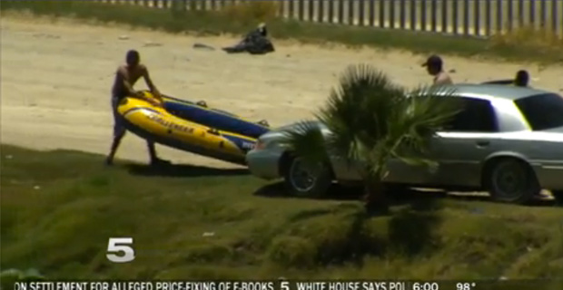 News crews captured human smugglers inflating rafts in Mexico and floating people into the U.S. / Credit: KRGV.com