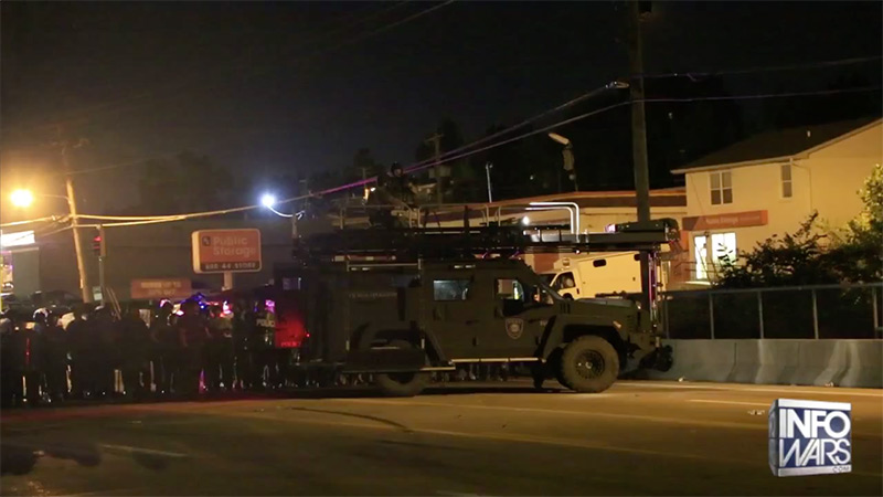 Police use armored vehicle to block a street.