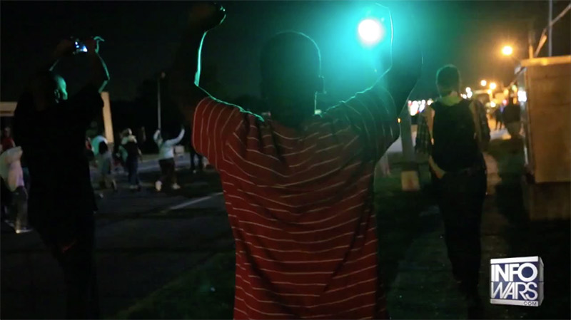 "Protesters chanted ""Hands up,"" and ""Don't shoot,"" during protests."