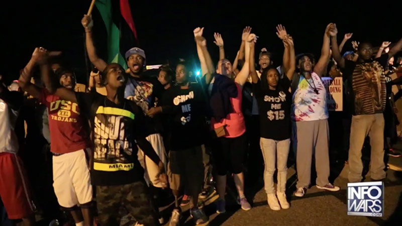 Ferguson protesters stood in solidarity last night, a far cry from the riots and looting seen Sunday night.