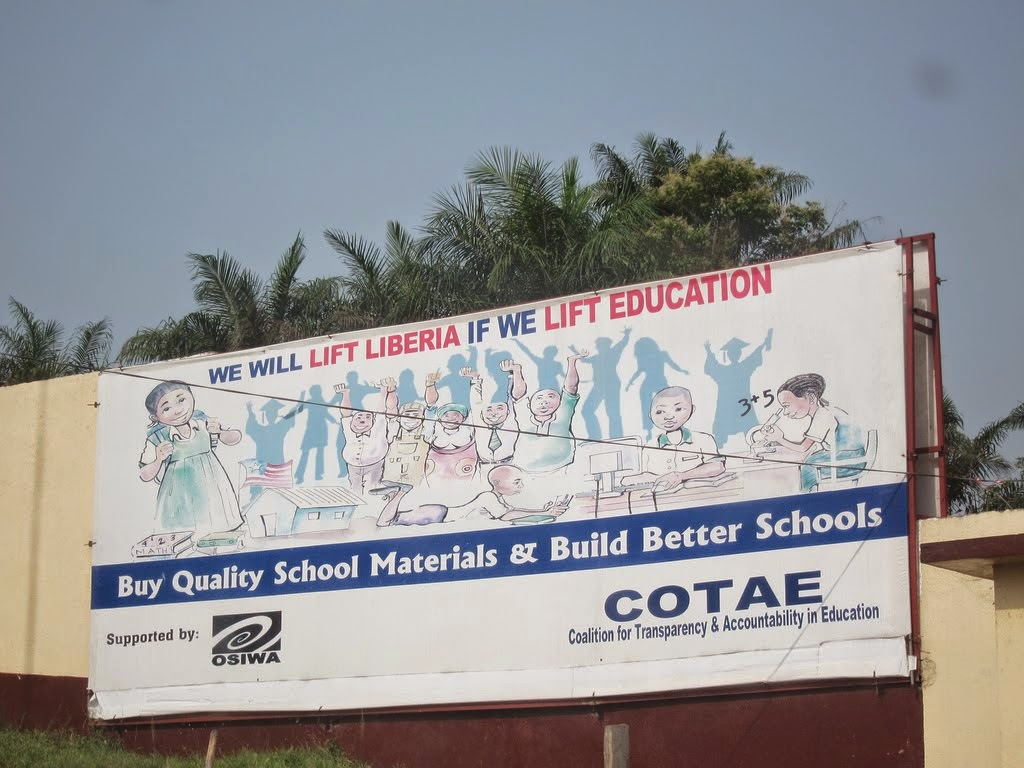 "Image: For years US and other Western NGOs have meddled in Liberia's internal affairs, claiming to be building up education and the nation's healthcare system. The US in particular has participated in military intervention in Liberia and has poured billions in cash in alleged ""aid."" Ironic then that Liberia is one of the worst hit and least prepared nations suffering from Ebola. Above is a billboard sponsored by Open Society in Liberia's capital of Monrovia."