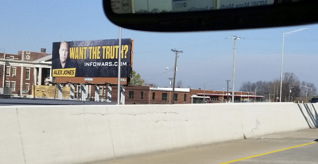 Who Is The Mysterious Infowarrior Posting Billboards Nationwide?