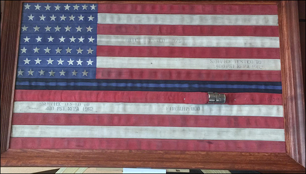 Flag made of used fire hoses donated to Sheriff by local fire department /  Image credit: WTKR.com
