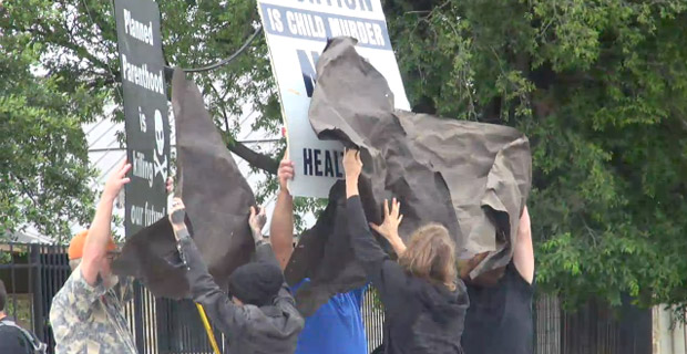 Obama Supporters Censoring Signs at #BlackLivesMatter Abortion Protest