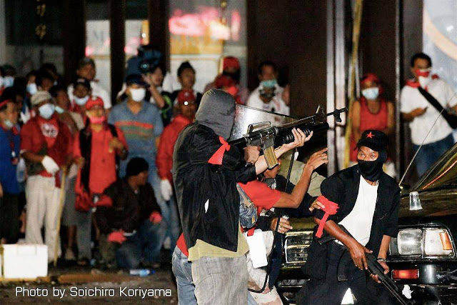 Image: Shinawatra's 300 armed militants employed M16s, AK47s, M79 grenade launchers, hand grenades, pistols, and sniper rifles turning Bangkok into a warzone in 2010, killing nearly 100 and injuring hundreds more. The weeks of gun battles culminated in mass arson across the city, leaving many major buildings gutted. While no single attack has matched the scale of Monday's bombings, Shinawatra's armed campaign in 2010 easily exceeded it.