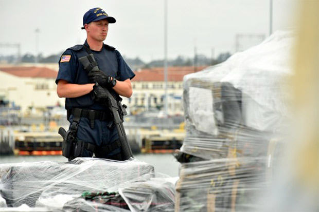 The crew of the Coast Guard Cutter Stratton stands by to offload 34 metric tons of cocaine in San Diego on Monday, Aug. 10, 2015. The drugs were seized in 23 separate interdictions by Coast Guard cutters and Coast Guard law enforcement teams operating in known drug transiting zones, resulting in one of the largest cocaine offloads in U.S. history, valued at more than $1 billion. U.S. Coast Guard photo by Petty Officer 2nd Class Patrick Kelley. - See more at: http://coastguard.dodlive.mil/2015/08/in-the-zone-stratton-offloads-more-than-66000-pounds-of-cocaine/#sthash.tcohC0Yz.dpuf