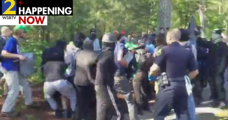 Police in Riot Gear as Hundreds Clash at 'Pro-white rally'