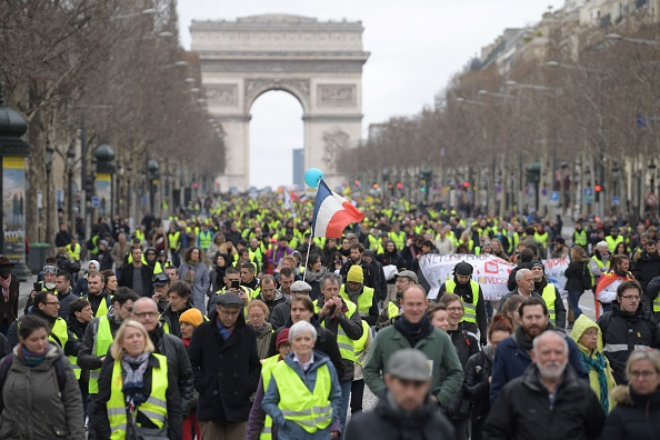 Tear Gas VS. Flowers: Yellow Vests March Through Paris For 16th Week