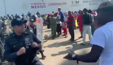 VIDEO: African migrants hurl garbage cans, tents at Mexican police, demand passage to US