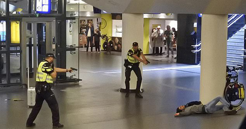 Afghan 'who stabbed two American tourists' at Amsterdam train station says he travelled to Holland 'to protect the Prophet Mohammed' and 'kill unfair and cruel people'