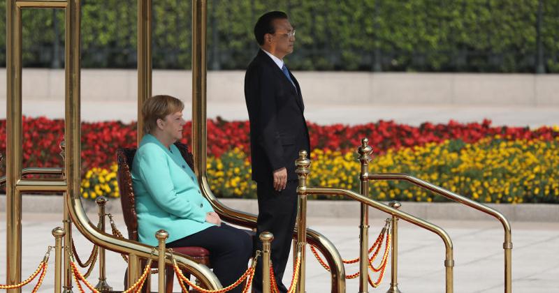 Merkel Sits for German National Anthem During China Visit
