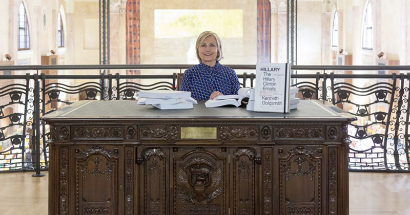 Update: Hillary Clinton Reads Emails While Pretending To Be President At Art Exhibit