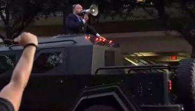 Highlights: Alex Jones Rides Into Trump Rally In Armored Beast