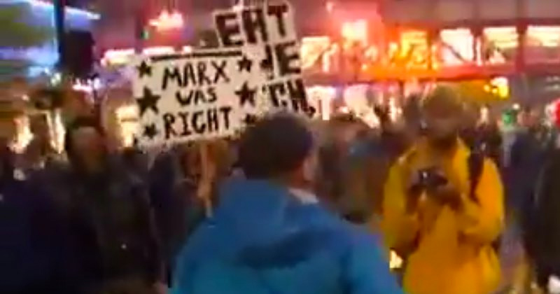 "Leftists Hold ""Marx Was Right"" Sign – While Hong Kong Protesters Beg for Liberation from Communism"