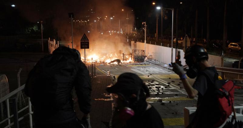 Hong Kong Riot Police Fire Tear Gas at University Campus