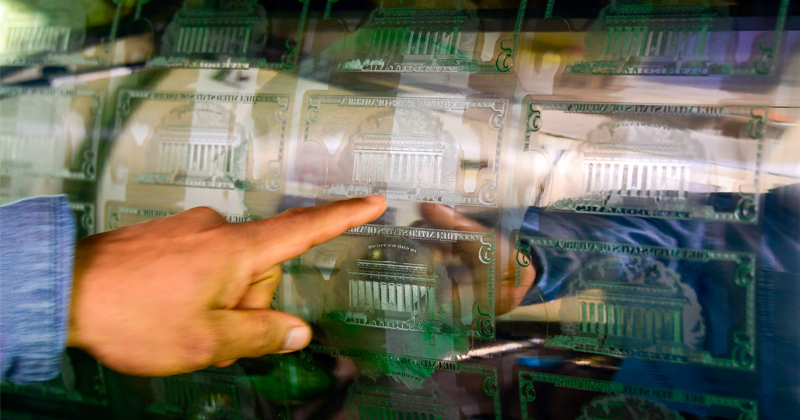 Fed Printing Money, But Incentivizing Banks to Hold Cash
