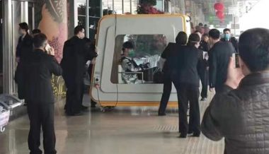 Video: Man With Suspected Killer Virus Wheeled Away in Huge Box