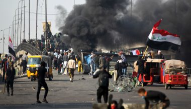 Iraqis Split on Parliament's Call to Expel Foreign Troops