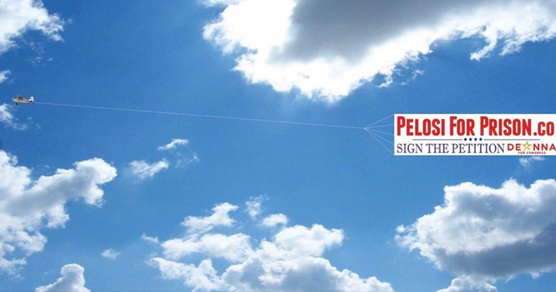 """Exclusive Interview: California Candidate Flying """"Pelosi For Prison"""" Banner"""