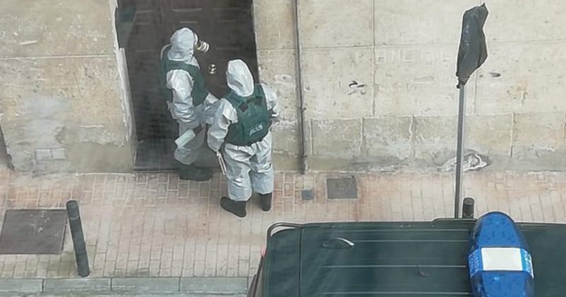 WAR ON BUGS Coronavirus patients in Spain forced to stay in their homes by TERROR cops in hazmat suits