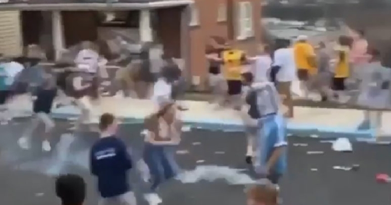WATCH: Police use tear gas as drunk students block street, throw beer bottles