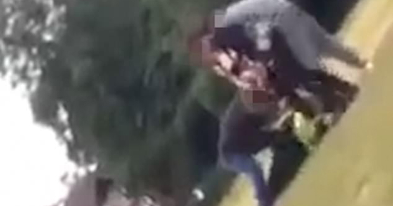 Shocking moment mob of teenagers kick police officer and drag him across the floor after he challenged them for flouting lockdown rules in park