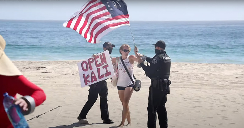 Defiance: Crowd Converges After Cops Threaten to Arrest Woman Protesting Beach Closure
