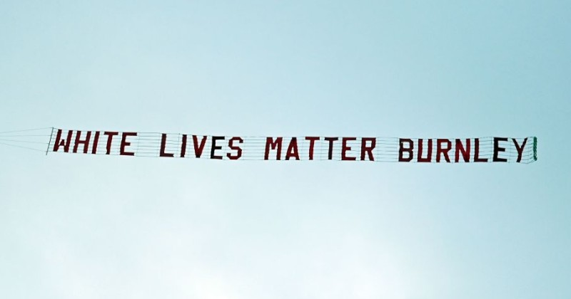 """Girlfriend of Man Who Flew """"White Lives Matter"""" Banner Fired From Her Job"""