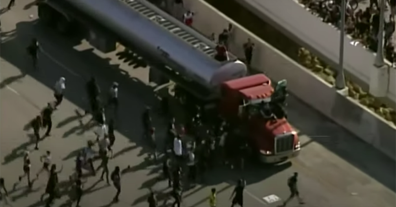 WATCH Minneapolis protesters BLOCK TRUCK with their BODIES, barely keep from LYNCHING driver who plowed through crowd