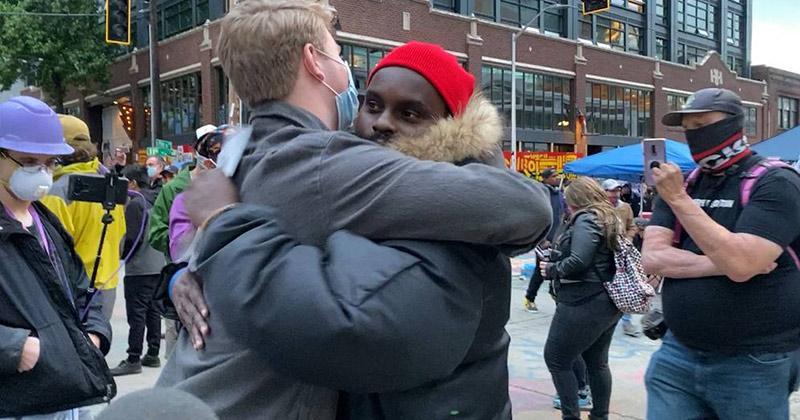 Black & White Protesters Debate The Black Lives Matter Message