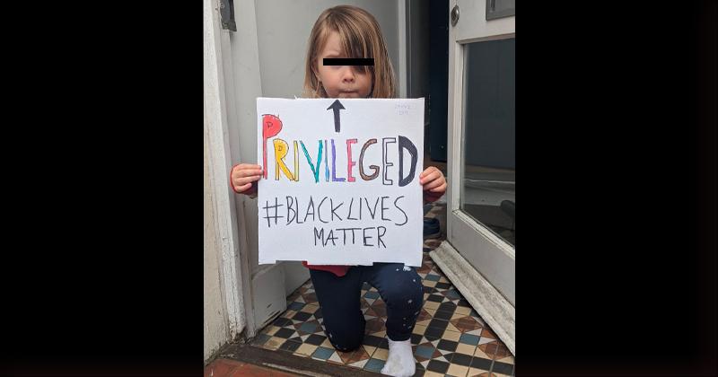 """Shame: White Child Kneels, Holds """"Privileged"""" White Guilt Protest Sign"""